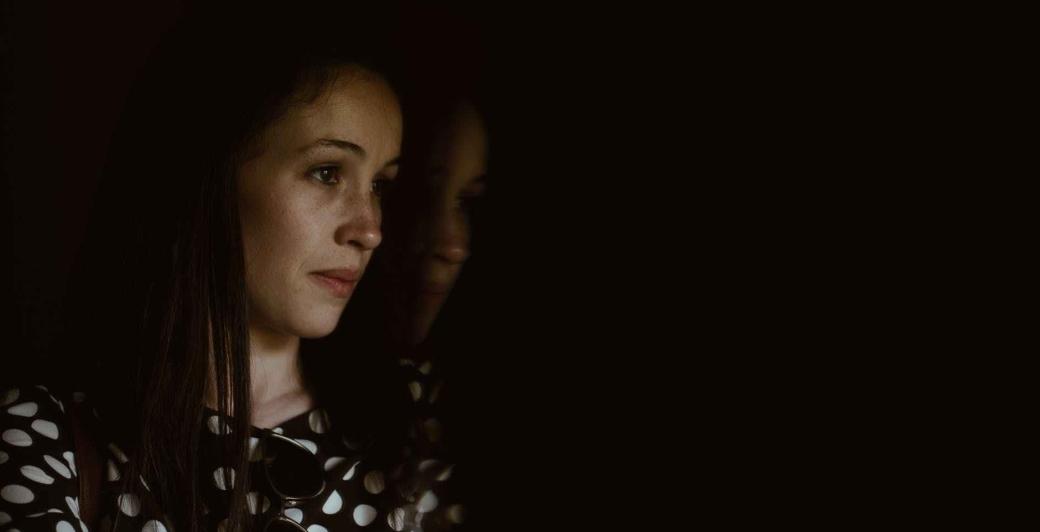 woman wearing black and white polka dot shirt