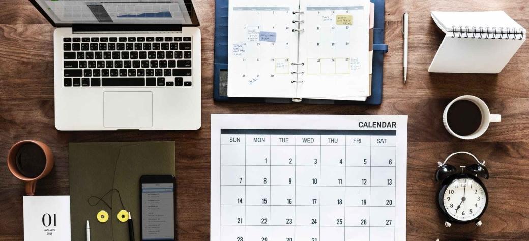 laptop calendar and books
